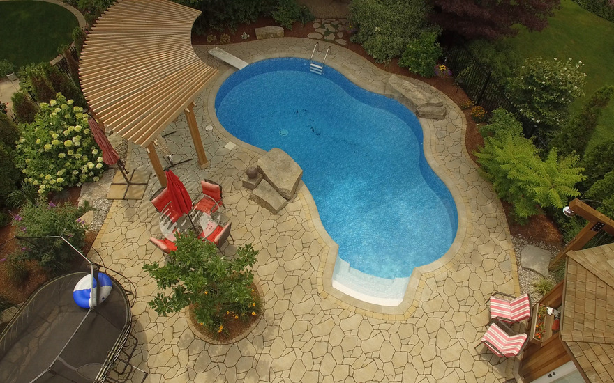 Pool surrounded by interlock bricks